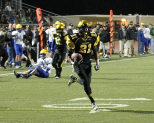 El Capitan running back Isaiah Capoocia heads into the end zone for a touchdown during El Capitan's semifinal win over visiting Brawley in Lakeside on Nov. 28, 2014.